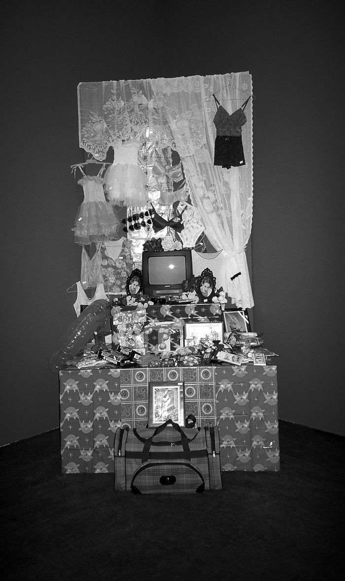 Gulsun 10 Fig. 10. Gülsün Karamustafa, <i>Objects of Desire, Suitcase Trading (Limit 100 Dollars)</i> (1998), performance. Money-Nation Exhibition, Shedhalle, Zurich.
